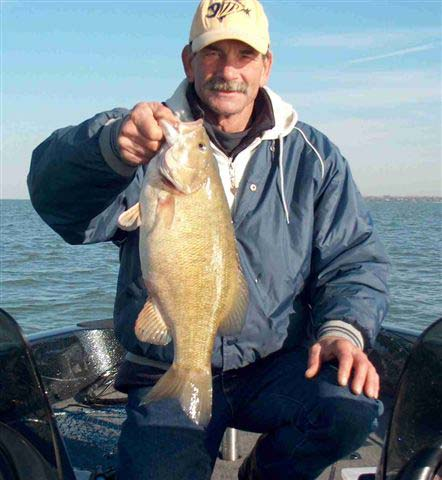 Guy's-Only-Fishing---Golden-Reel-Charter-Fisherman-with-Bass1.jpg